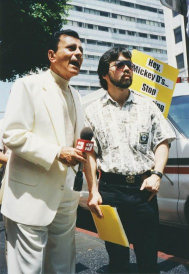 """Casey Kasem and Guy Aoki speak out against KKBT-FM's """"House Party"""" in 1995 outside the Hollywood McDonald's."""