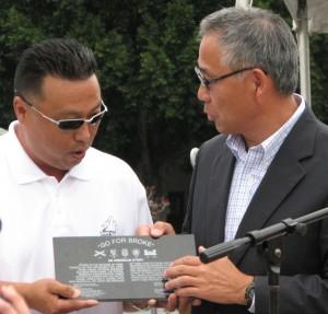 Doi receives an award from GFBNEC President Don Nose.