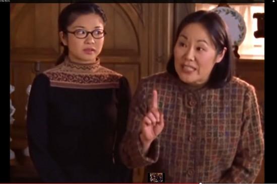 Lane (Keiko Agena) listens nervously as Mrs. Kim (Emiliy Kuroda) speaks at a Thanksgiving dinner.