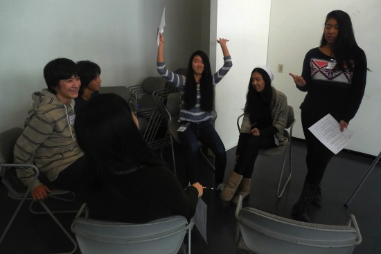 "Byron Brown, Hiro Ozaki, Sharyse Watanabe, Michele Hirano, and Erika Higa prepare for their ""Speak to Persuade"" presentation."