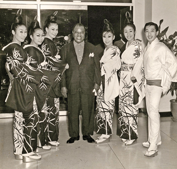 The troupe's unique style and singular skill endeared them to other stars. A shot from the early 1960s shows, from left: Akemi (no last name given), Yoneko Takeuchi, Antonia Ellis, Louis Armstrong, Kiyoko Binosi, Mariko (no last name), and Takeuchi.