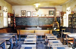 The classroom measures 18 by 24 feet and has the original wooden student desks and presidential portraits.