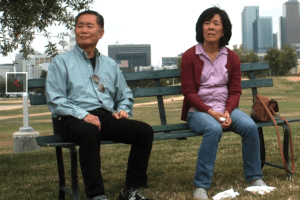 """George Takei and Sharon Omi in a scene from """"Eat with Me."""""""