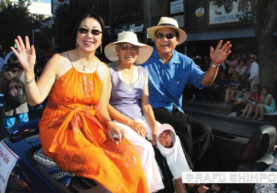 Fujioka, joined by his wife Darlene and mom Linda, ride in this year's Nisei Week Grand Parade.