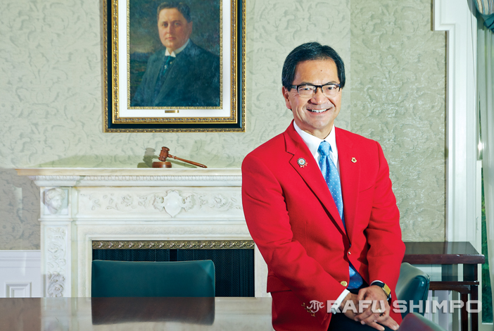 With a portrait of William Wrigley looking over his shoulder, Tournament of Roses President Richard L. Chinen relaxes in the executive meeting room at the Tournament House in Pasadena, the former home of Wrigley. (MIKEY HIRANO CULROSS/Rafu Shimpo)