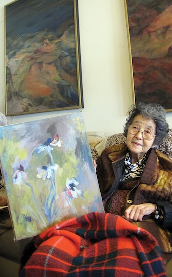 Shizue Yamashiro shows some of her paintings. Married in 1963, the couple support one another's creative endeavours.