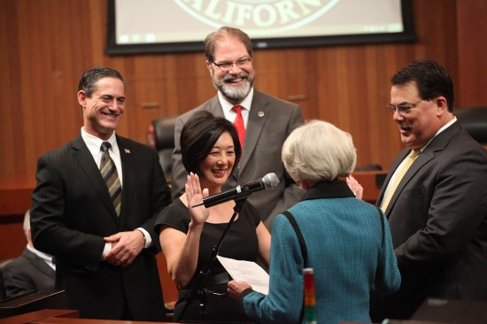 Lisa Bartlett is administered the oath of office by former Supervisor Marian Bergeson. Orange County Supervisors Todd Spitzer (vice chair), John Moorlach, Lisa Bartlett; Marian Bergeson, former supervisor, assemblywoman and state senator; Supervisor Shawn Nelson (chair).