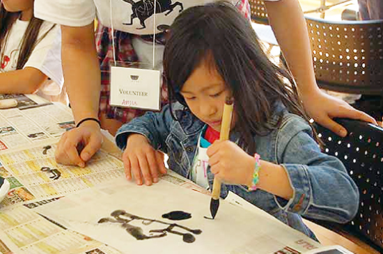 Learning calligraphy at the Oshogatsu workshop at JACCC.