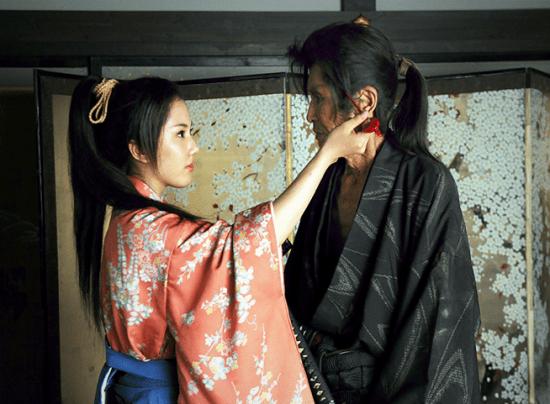 "Chihiro Yamamoto and Seizo Fukumoto in a scene from ""Uzumasa Limelight."""