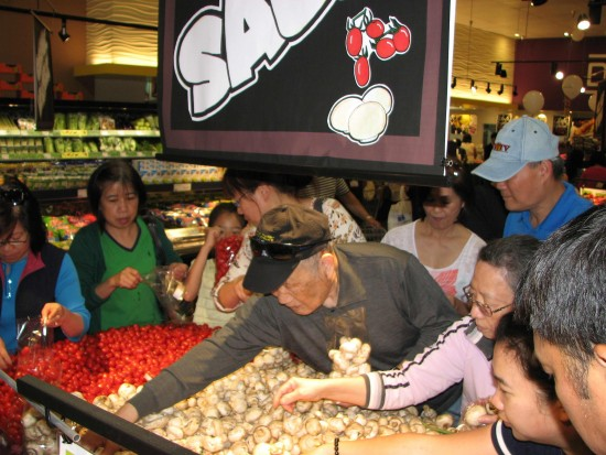 Customers take advantage of bag sales in the produce section.