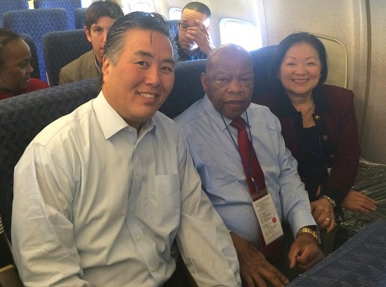 Rep. Mark Takano of Riverside and Sen. Mazie Hirono of Hawaii en route to Selma with Rep. John Lewis of Georgia, who participated in the 1965 march.