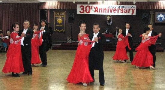 David Shinjo and Gira Nakamoto (center) performed a demonstration of international tango and waltz with the Monday Night Formation Class.