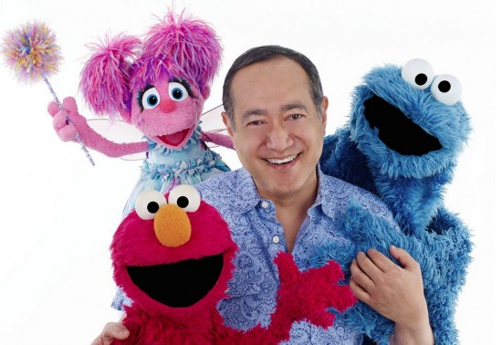 """Alan Muraoka with some of his """"Sesame Street"""" friends."""