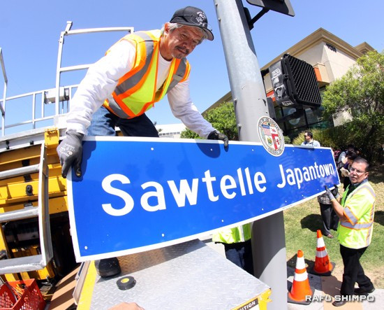 City workers install the Sawtelle Japantown sign.