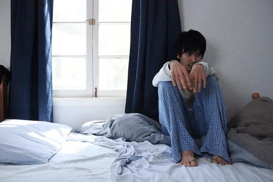 "Isamu isolates himself from society in a scene from ""American Hikikomori."" (Photo courtesy of Landis Stokes)"
