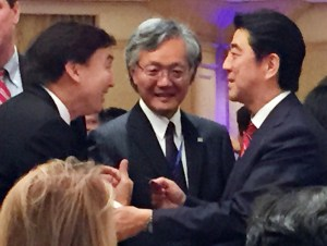 Union Bank executive Paul Abe, left, greets the Japanese prime minister, as the two were schoolmates at USC. Looking on is Consul General Harry Horinouchi. (Photo courtesy Paul Abe)
