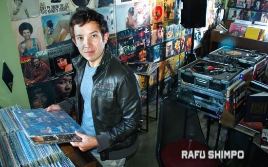 Joseph Morales finds an album by The Who at The Artform Studio, a record store and hair salon next door to The Rafu Shimpo. (MIKEY HIRANO CULROSS/Rafu Shimpo)