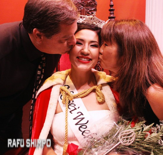 Hutter's parents, Ralph and Joy, give her a congratulatory kiss.