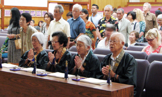 As temple leaders chant, memorial service attendees line up to pay their respects to the Hiroshima-Nagasaki victims.
