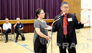 Jonathan Kaji, a spokesman for the Ad Hoc committee, speaks after refusing a request by Keiro's Audrey Lee-Sung to stop because the meeting time had expired. (NAO NAKANISHI/Rafu Shimpo)