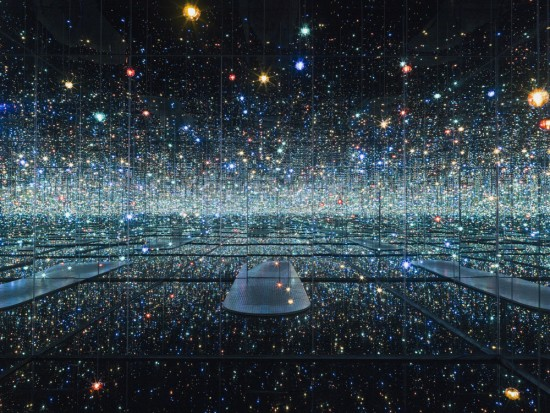 """Yayoi Kusama, """"Infinity Mirrored Room - The Souls of Millions of Light Years Away,"""" 2013, wood, metal, glass mirrors, plastic, acrylic panel, rubber, LED lighting system, acrylic balls, and water, 113 1/4 x 163 1/2 x 163 1/2 in., © Yayoi Kusama. Courtesy of David Zwirner, N.Y."""