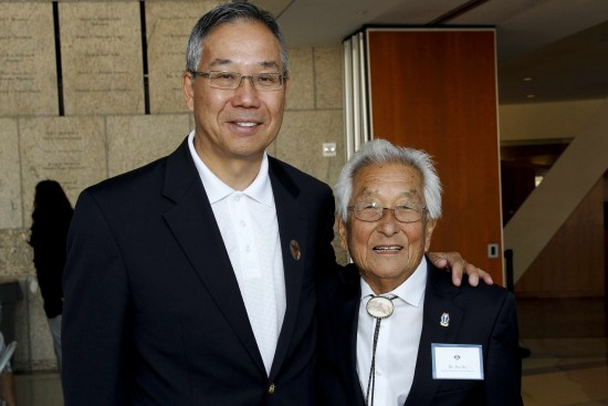 """Sus Ito with Don Nose, president of the Go For Broke National Education Center, at JANM during an event held in conjunction with """"Before They Were Heroes."""""""