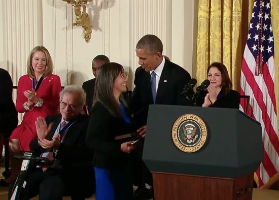 Laurie Yasui accepts her father Min Yasui's Presidential Medal of Freedom from President Obama.