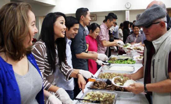 Kizuna board members serve community member supporters at Kizuna's volunteer and donor appreciation luncheon.