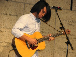 Peter Chung performs during the reception.
