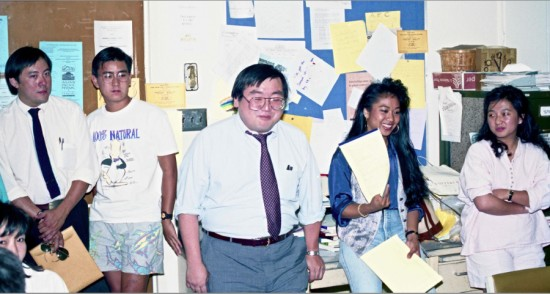 """In May 1989, Don Nakanishi won a three-year battle against UCLA for tenure. After being officially granted tenure at Chancellor Charles Young's office, Nakanishi had a small celebration at the Student/Community Projects office at the Asian American Studies Center in Campbell Hall. It was a victory not only for Nakanishi but also for the field of Asian American studies, as his research was initially considered """"irrelevant"""" by his tenure review committee. (Photo courtesy of Gann Matsuda)"""