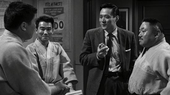 "James Shigeta (second from right) in a scene from ""The Crimson Kimono."" At left is future Rafu columnist George ""Horse"" Yoshinaga."