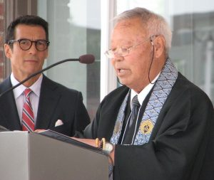 Rev. George Matsubayashi spoke on behalf of Nishi Hongwanji Buddhist Temple. At left is emcee David Ono of ABC7 Eyewitness News.
