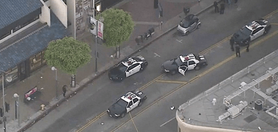 Aerial view of police cars on First Street outside Japanese Village Plaza. (CBS Los Angeles)