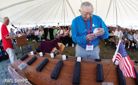 Jimi Yamaichi addresses the attendees as Hiroshi Kashiwagi lights the electric candles prior to the start of the memorial program at this year's Tule Lake pilgrimage held over the July 4th weekend. (MARIO G. REYES/Rafu Shimpo)