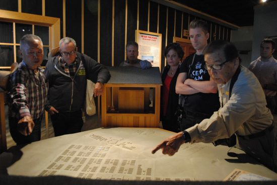 George Takei and HMWF board member Sam Mihara discuss the map exhibit at the Heart Mountain Interpretive Center.