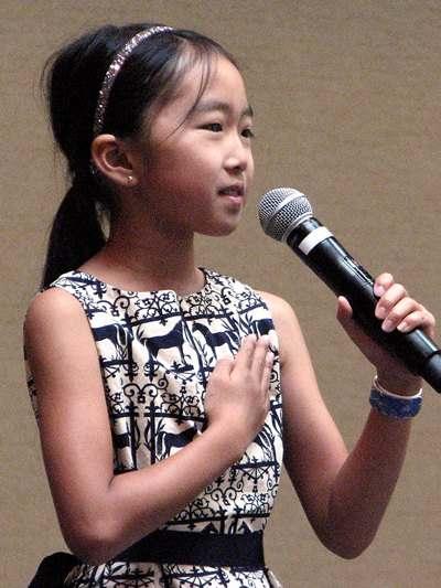 Fourth-grader Chihiro Kato led the Pledge of Allegiance.