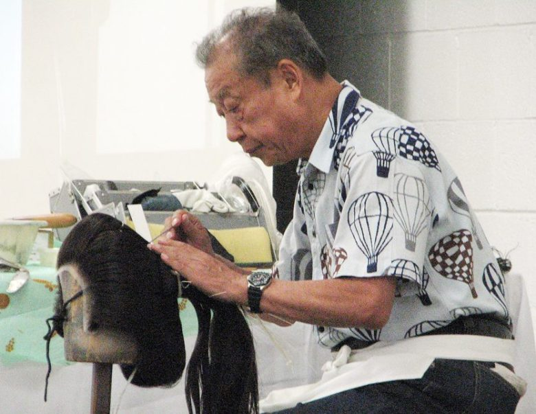 Tokuo Toyotani demonstrates his skills as a tokoyama, who combs and stylizes wigs.