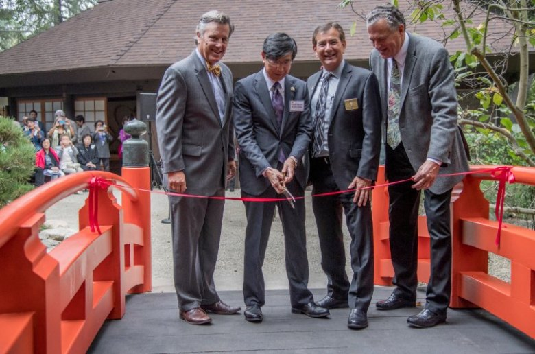 Tim Morphy, Descanso Gardens Board of Trustees chair, Akira Chiba, consul general of Japan in Los Angeles, John Wicker, director of Los Angeles County Parks and Recreation, and David Brown, Descanso Gardens executive director, cut the ribbon for the rededication ceremony of the recently restored Japanese Garden bridge. (Photo by Martha Benedict)