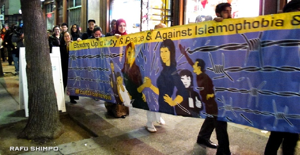 Marchers on Second Street carried a banner expressing solidarity between Japanese Americans and Muslim Americans against Islamophobia. (MARIO G. REYES/Rafu Shimpo)