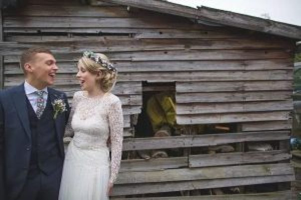 bride and groom laughing at Hilltop country house wedding