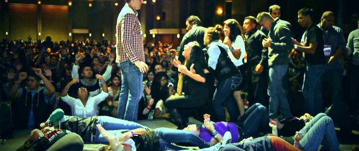 """People """"Slain in the Spirit"""" at a Pentecostal church service - one of many Christian Charismatic movements"""