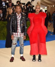 Pharrell Williams' wife wears Comme des Garcons.