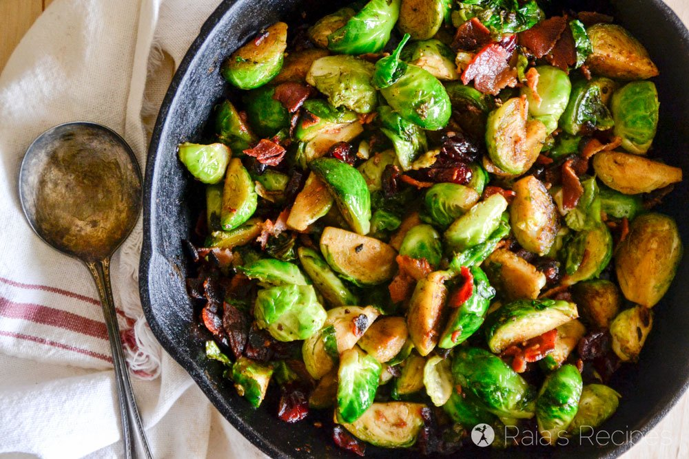 These Pan Fried Brussels Sprouts with Bacon & Dried Cranberries are an easy and delicious side your family will love! | RaiasRecipes.com