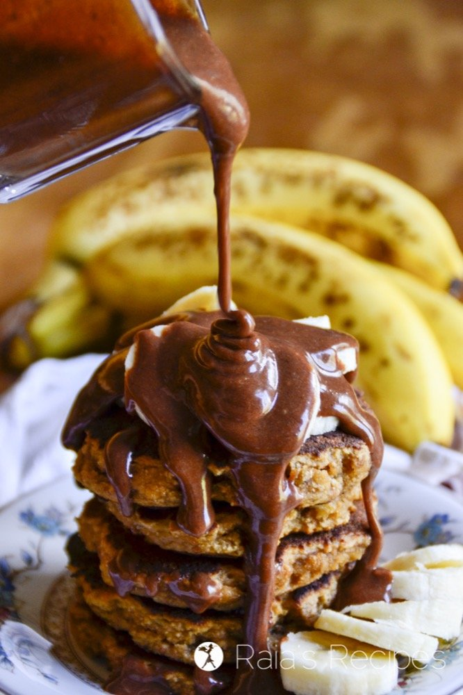 Perfectly fluffy and deliciously simple, these paleo Coconut Flour Banana Pancakes with Chocolate Nut Butter Syrup are sure to hit the spot any morning!   RaiasRecipes.com