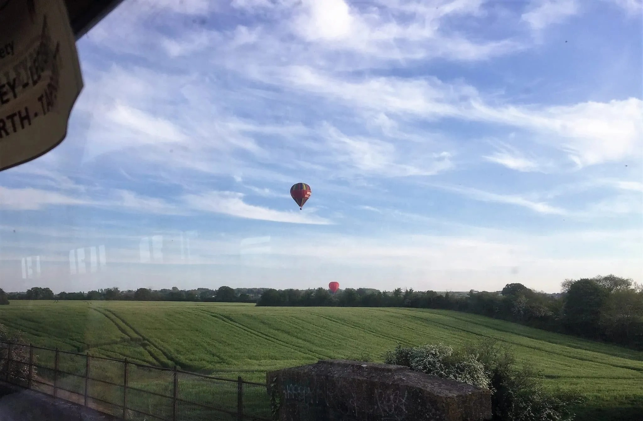 View from the Avon Valley Railway of hot air balloons