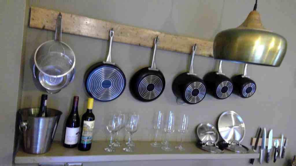 Kitchen paraphernalia on wall