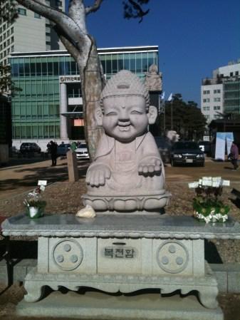 A smiling stone Buddha.