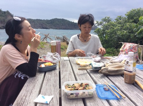 Eating and sharing bento lunches.