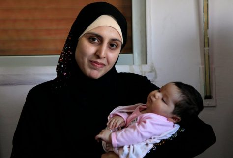 a_syrian_refugee_and_her_newborn_baby_at_a_clinic_in_ramtha_jordan_9613483141