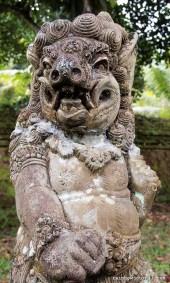 One of the many stone guardians surrounding Tirta Empul.